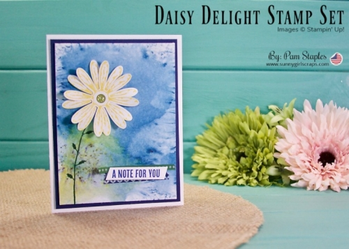 Handmade card created by Pam Staples, SunnyGirlScraps featuring a Bold Yellow Daisy against a deep blue Brusho Crystal Color background. A Facebook Live Video details how the card is created. Order your supplies at www.sunnygirlscraps.com #brusho #watercolor #daisydelight #daffodildelight #stampinup #sunnygirlscraps #papercraft #papercrafts #craft #crafts #crafter #handmade #makersgonnamake #washitape #creative #create