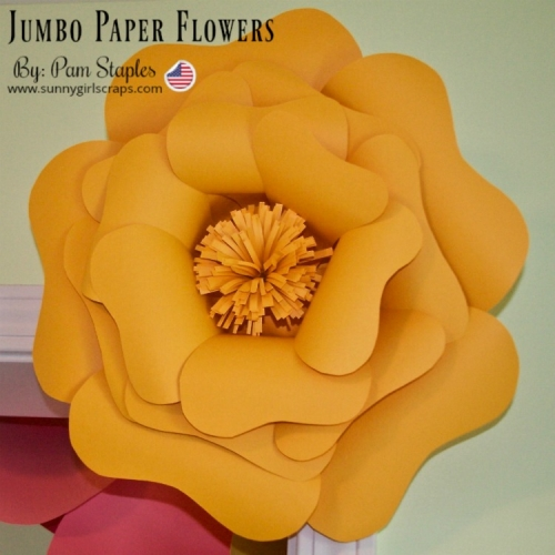 Jumbo Paper Flowers hanging on a door and in a foyer of a home.